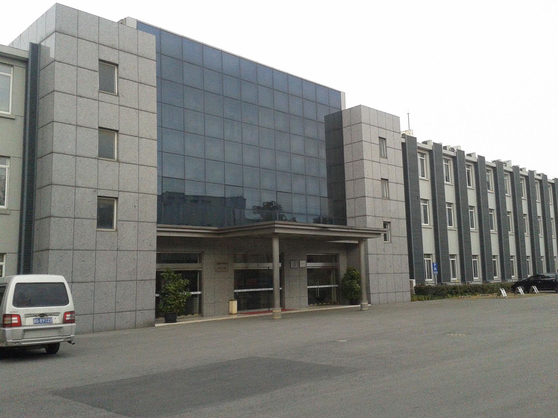 原厂俱乐部旧址现已改建成厂部办公楼.jpg